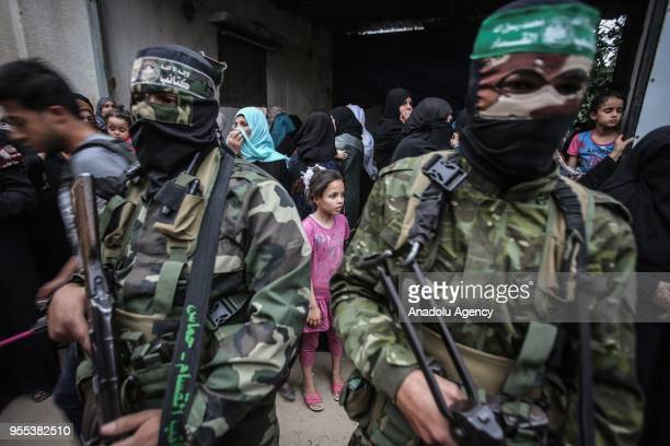 Members of Izz adDin alQassam Brigades which is the military wing of the Palestinian Hamas organization attend the funeral ceremony of Beha...