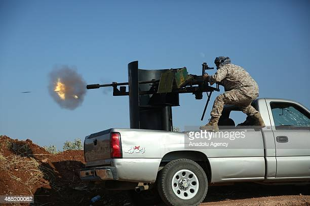 Members of Jabhat asSham forces attack on Daesh terrorists at Handarat region of Aleppo Syria on August 25 2015