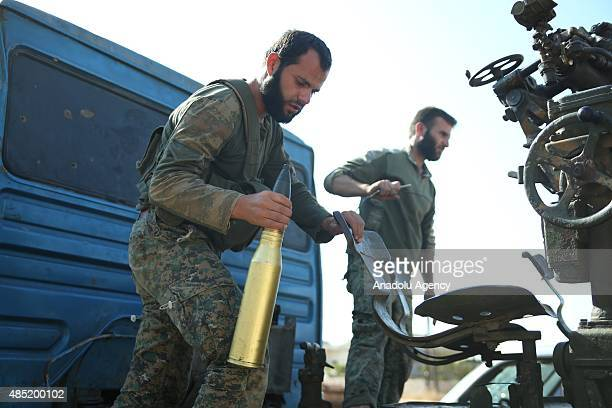 Members of Jabhat asSham forces make preparations before they attack on Daesh terrorists at Handarat region of Aleppo Syria on August 25 2015
