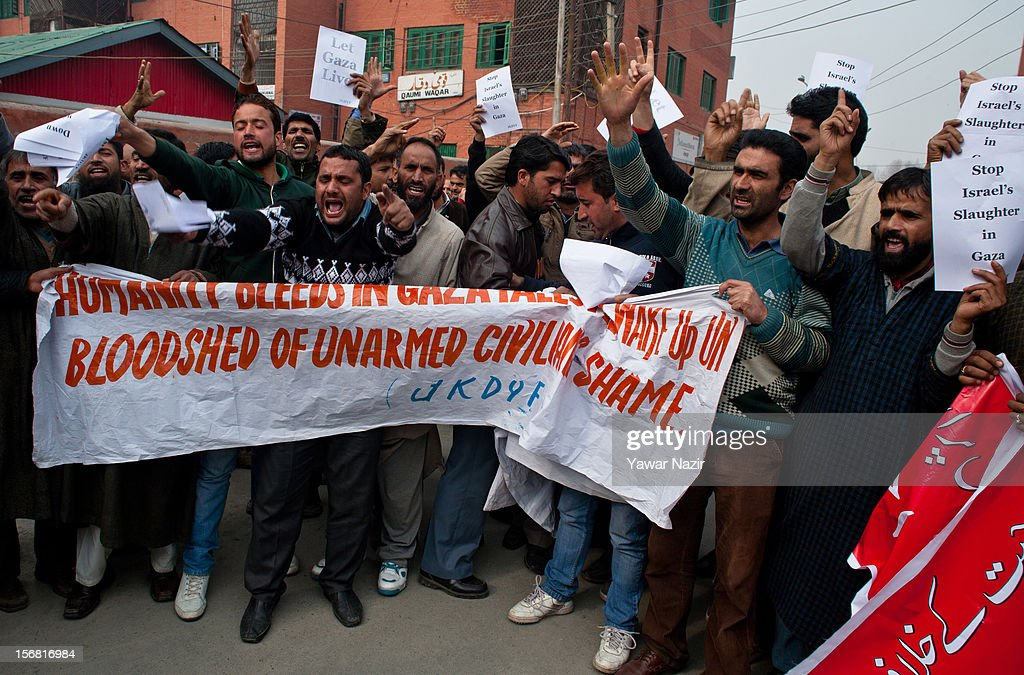 Members of Jammu and Kashmir Democratic Youth Federation (JKDYF) an organisation which stands for communal harmony shout anti American and anti Israeli slogans during a protest against Israel and in solidarity with Gaza on November 22, 2012 in Srinagar, the summer capital of Indian administered Kashmir, India. Dozens of members of JKDYF were detained by Indian police when they were protesting against the recent Israeli strikes on Gaza