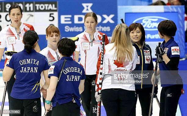 Members of Japan and Canada shake hands after a round-robin match between Japan and Canada during day six of the World Women's Curling Championship...