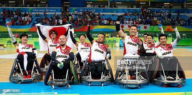 Members of Japan celeberate winning the bronze medals after the Wheelchair Rugby bronze medal match between Japan and Canada at Carioca Arena 1 on...