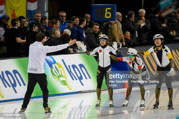 Members of Japan celebrate after breaking the ladies team pursuit world record during the ISU World Single Distances Speed Skating Championships on...