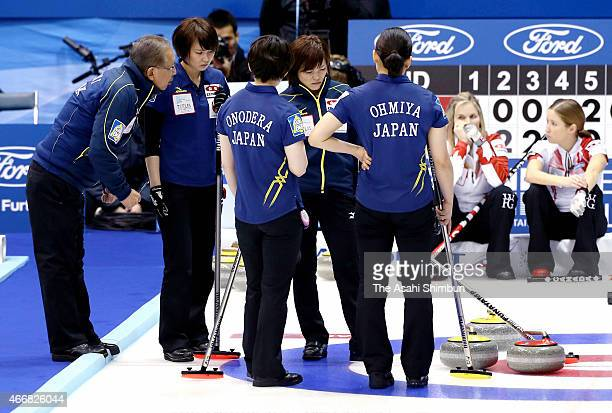 Members of Japan discuss at the 8th end during a round-robin match between Japan and Canada during day six of the World Women's Curling Championship...
