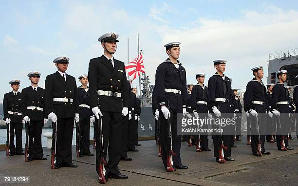 """Members of Japan Maritime Self Defense Force attends a send-off ceremony for convoy """"Murasame"""" departing for the Indian Ocean from their Yokosuka..."""