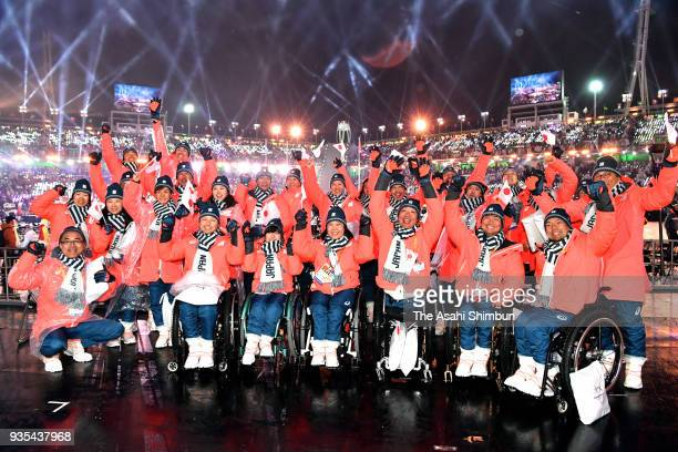 Members of Japan pose for photographs during the closing ceremony of the PyeongChang 2018 Paralympic Games at the PyeongChang Olympic Stadium on...