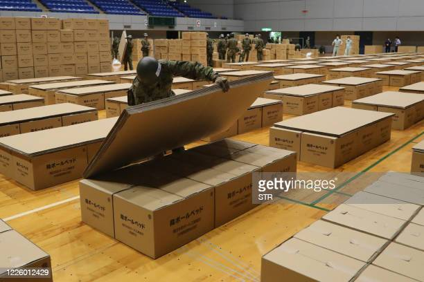 Members of Japan Self-Defense Forces install cardboard beds as they prepare a shelter for flood-affected residents in Hitoyoshi, Kumamoto prefecture...