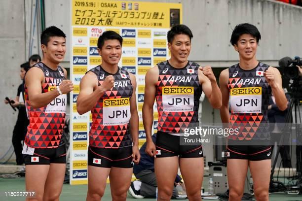 Members of Japan team, Yoshihide Kiryu, Yuki Koike, Ryota Yamagata and Shuhei Tada pose for photographers after winning the Men's 4 x 100m Relay...
