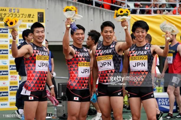 Members of Japan team Yoshihide Kiryu Yuki Koike Ryota Yamagata and Shuhei Tada pose for photographers after winning the Men's 4 x 100m Relay during...