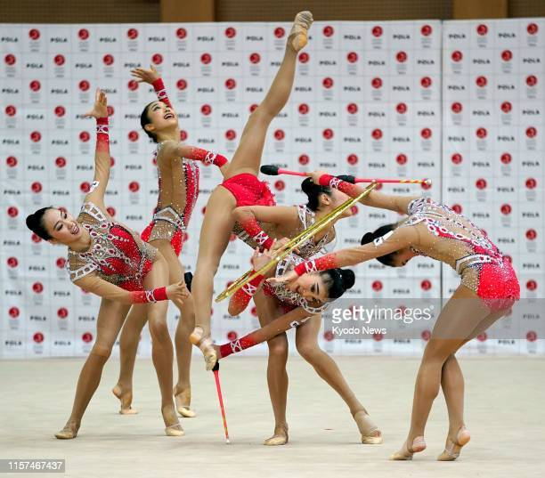 Members of Japan women's rhythmic gymnastics team known as Fairy Japan practice in Tokyo on July 24 exactly a year before the opening of the Tokyo...