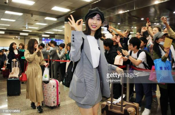 Members of Japanese idol girl group AKB48 arrive at an airport for their concert on October 18, 2019 in Taipei, Taiwan of China.