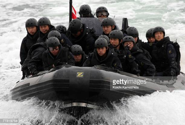 Members of Japanese Navy approach a suspicious ship during the Proliferation Security Initiative Maritime Interdiction Exercise 'Pacific Shield 07'...