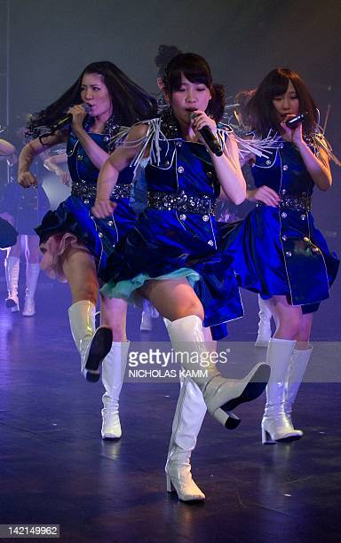 Members of Japanese pop group AKB48 perform at the Lincoln Theater in Washington on March 27, 2012. The band is in the US capital as part of the...