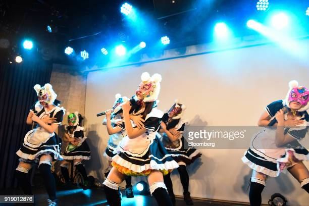 Members of Japanese pop group 'Virtual Currency Girls' perform onstage in Tokyo Japan on Friday Feb 16 2018 The eightmember girl group held a concert...
