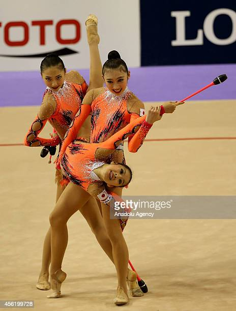 Members of Japanese rhythmic gymnastics team compete during the 33rd Rhythmic Gymnastics World Championships in Izmir Turkey on September 27 2014