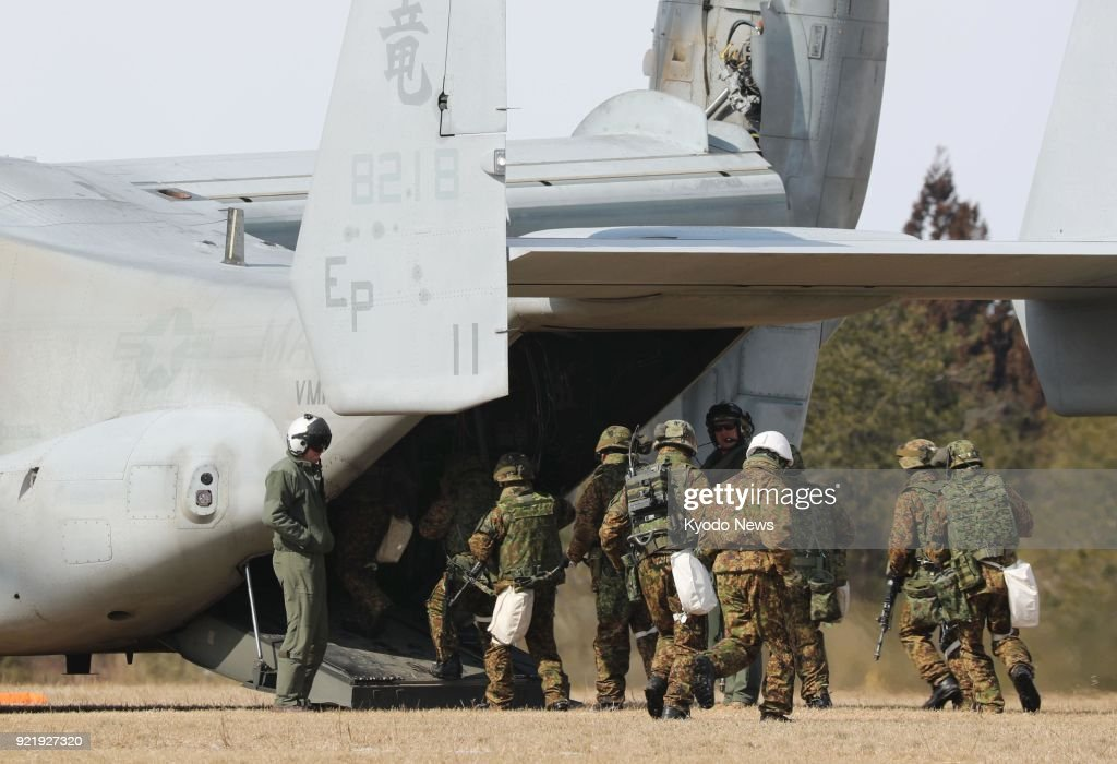 Members of Japan's Ground Self-Defense Force board an Osprey transport aircraft of the U.S. Marine Corps during a joint drill at the Ojojihara training ground in Miyagi Prefecture, northeastern Japan, on Feb. 21, 2018. ==Kyodo