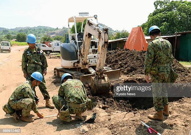 Members of Japan's Ground Self-Defense Force work near the main entrance to a facility for U.N. Peacekeeping operations in Juba, South Sudan, on Aug....