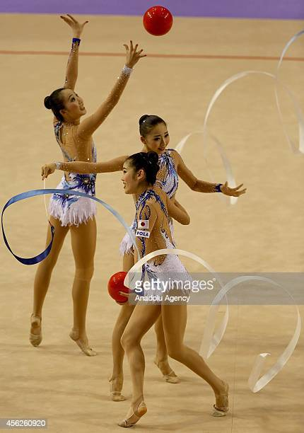 Members of Japan's rhythmic gymnastics team compete during the 33rd Rhythmic Gymnastics World Championships in Izmir Turkey on September 28 2014