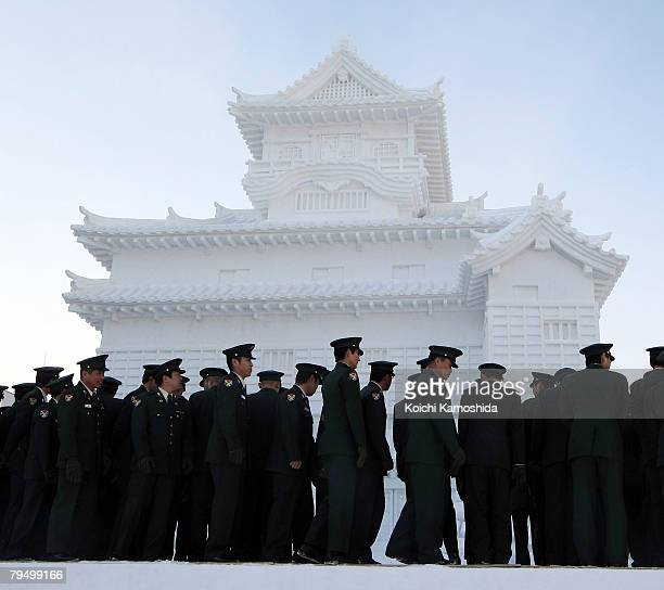 Members of Japan's Self Defence Force stand in front of a snow castle at Odori Park on February 4 2008 in Sapporo Japan The 59th Sapporo Snow...
