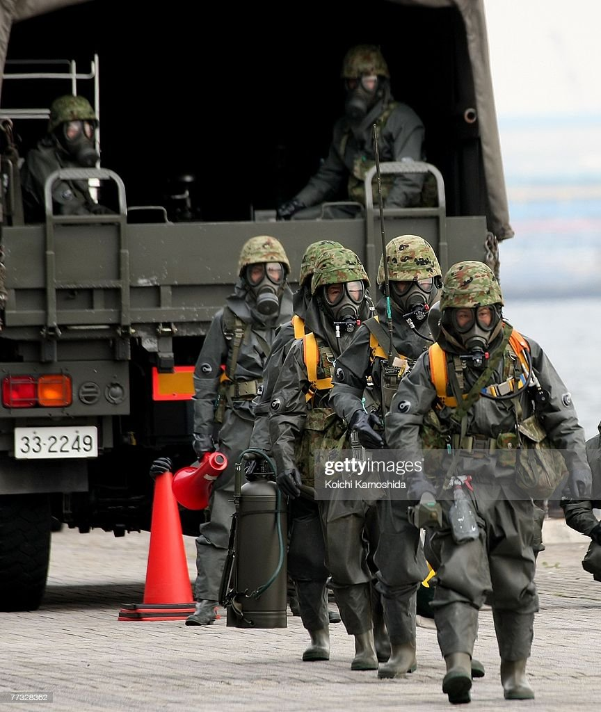 Members of Japan's Self-Defence Force exercise the removal of unidentified chemical substances with an anti-chemical suit during the Proliferation Security Initiative (PSI) Maritime Interdiction Exercise 'Pacific Shield 07', at Yokohama Port on October 15, 2007 in Kanagawa, Japan. Australia, France, New Zealand, Singapore, the U.K. and the U.S. will also participate in the Exercise. PSI is an international effort to halt the proliferation of weapons of mass destruction, missiles and related materials, threat to the peace and stability of the international community.