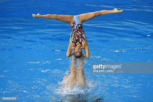 Members of Japan's team compete in the team free routine final synchronised swimming event during the 2014 Asian Games at the Munhak Park Taehwan...