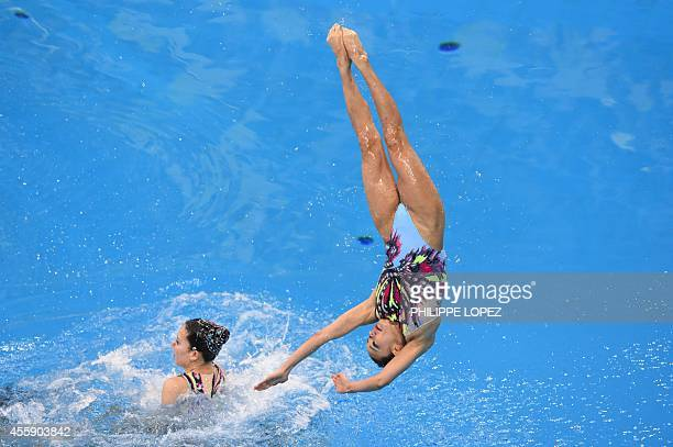Members of Japan's team execute a lift in the team free routine final synchronised swimming event during the 2014 Asian Games at the Munhak Park...
