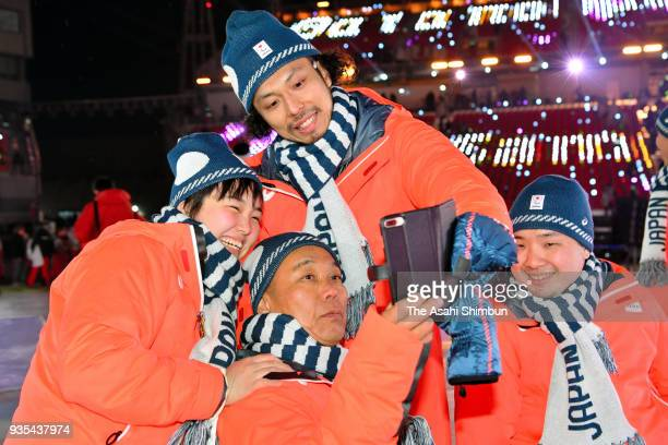 Members of Japan's Wheelchair Ice hockey team pose for photographs during the closing ceremony of the PyeongChang 2018 Paralympic Games at the...