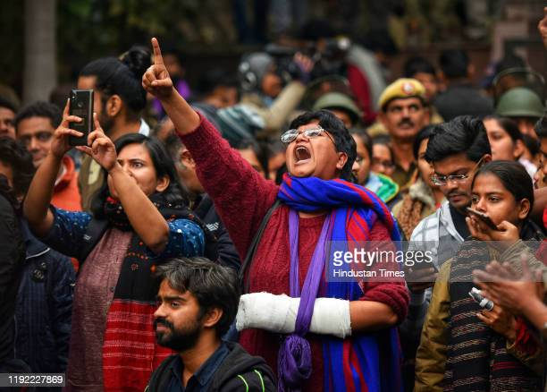 Members of Jawaharlal Nehru University Students Union shout slogans during a protest against the attack on JNU at JNU campus on January 6 2020 in New...