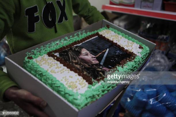 Members of Jewish Dwelling Unit Opponents Young Movement prepare a cake to celebrate birthday of 16yearold Palestinian Ahed alTamimi who was awarded...