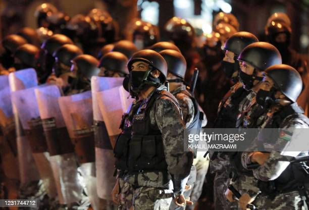 Members of Jordan's Darak forces stand on guard as protesters gather for a demonstration against measures imposed by authorities to curb the spread...