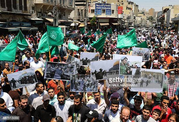 "Members of Jordan's Muslim Brotherhood and opposition parties shout slogans during a demonstration to protest against Israeli ""violations"" at..."