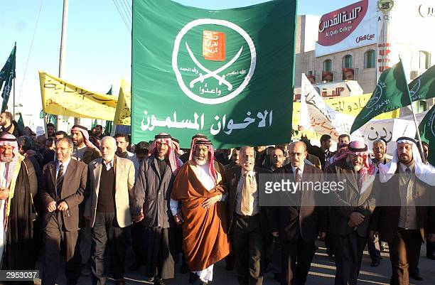 Members of Jordan's Muslim Brotherhood group lead a demonstration by around 600 people in the Jordanian capital Amman 09 February 2004 against the...