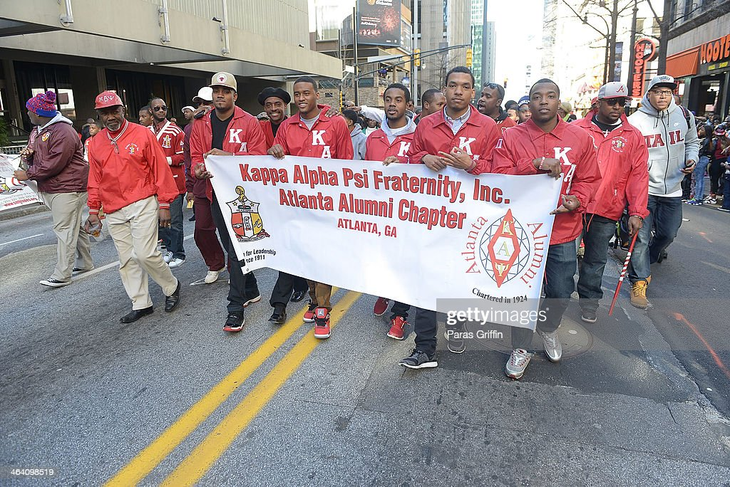Members of Kappa Alpha Psi Fraternity, Inc. participates in the 2014 Martin Luther King, Jr. March & Rally at Peachtree Street on January 20, 2014 in Atlanta, Georgia.