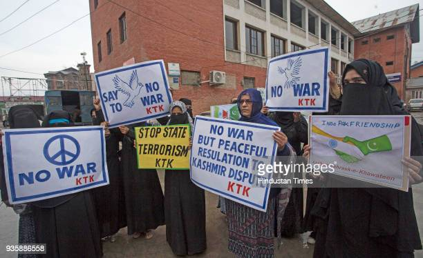 Members of Kashmir TehreekeKhawateen a women separatist group holding placards during a protest against civilian killings along Line of Control on...