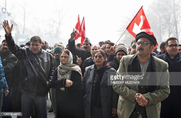 Members of Kashmir's National Conference party shout slogans during a protest against recent killings in Srinagar on November 26 2018 Eight people...
