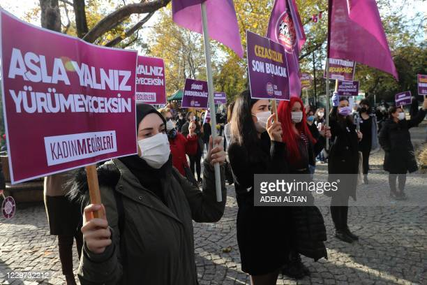Members of KCDP hold placards reading 'you'll never walk alone', during a protest for a better implementation of the Istanbul Convention and the...