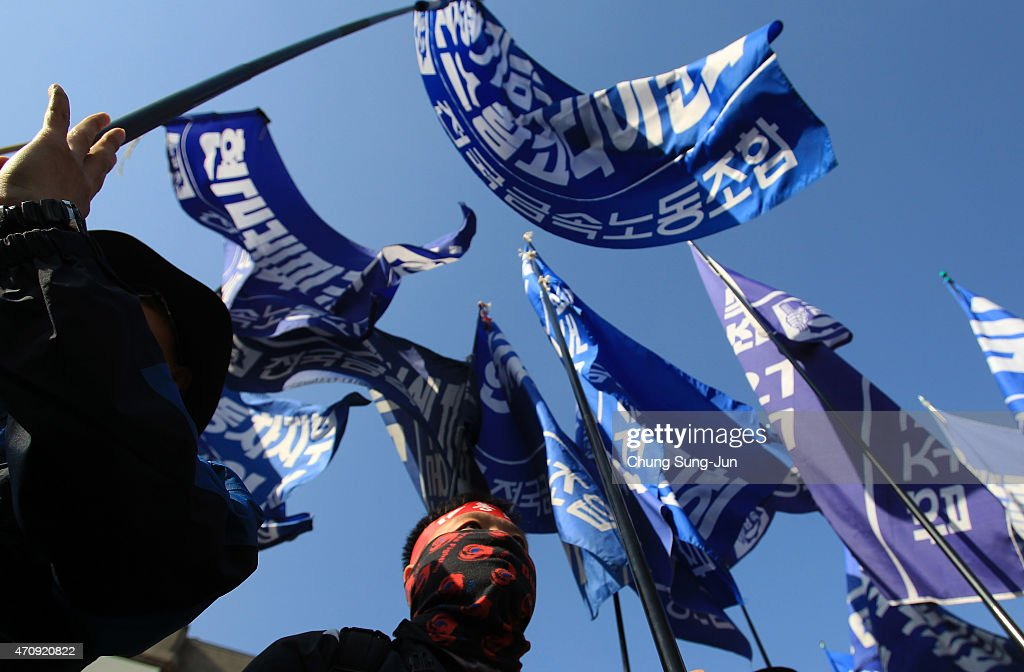 Members of KCTU participate in a anti-government protest on April 24, 2015 in Seoul, South Korea. Korean Confederation of Trade Unions (KCTU) went on a general strike in protest against the South Korean government's policy, including reformation of the labor market and public pension system. The rally was also joined by other civic groups in Seoul and families of Sewol accident victims.