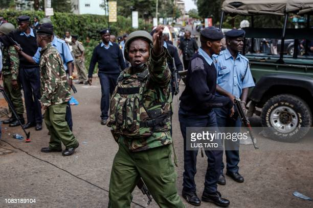 Members of Kenyan Security forces clear the entrance of the scene after the situation was taken under control after the terrorist attack at a hotel...
