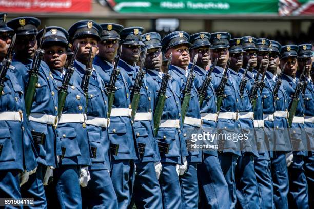 Members of Kenya's Air Force march in formation during the independence celebrations on Jamhuri Day at Kasarani stadium in Nairobi Kenya on Tuesday...