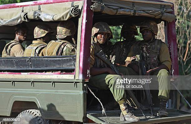 Members of Kenya's police force look out from the back of a truck as it enters the university campus of the northeastern town of Garissa on April 3...