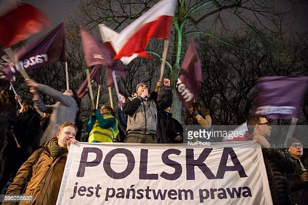 Members of KOD with quotPoland is country of lawquot banner during antigovernment demonstration in Warsaw on March 10 2016