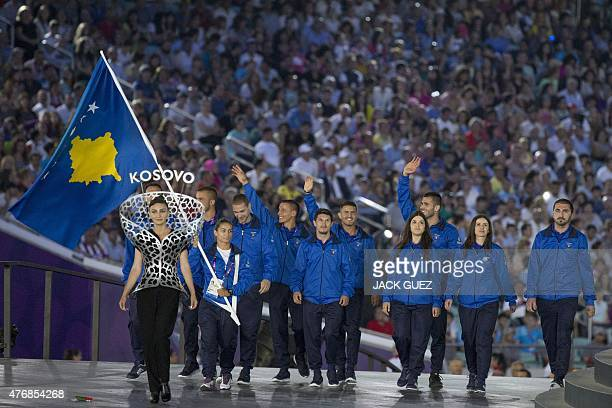 Members of Kosovo's delegation parade during the Opening Ceremony of the 2015 European Games at the Olympic Stadium in Baku Azerbaijan on June 12...