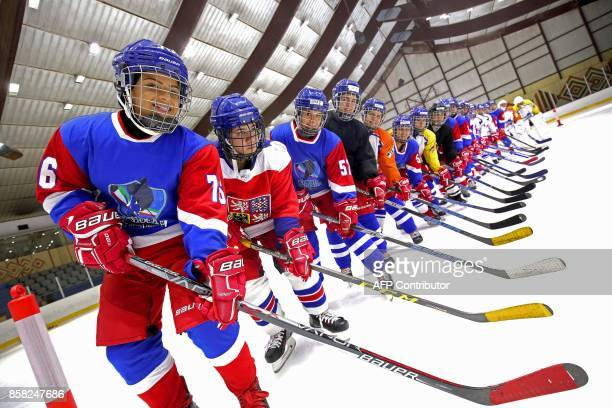 Members of Kuwait's women's ice hockey team take part in a training session at the ski lounge in Kuwait City on September 29 2017 Fiftysix Kuwaiti...