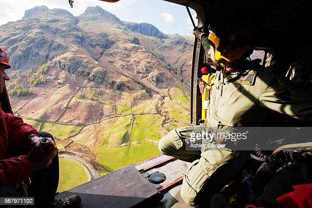 Members of Langdale/Ambleside Mountain Rescue team and an RAF whinch man in an RAF Sea King helicopter during a rescue in Dungeon Ghyll in the Langdale Pikes, UK.