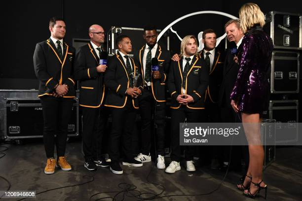 Members of Laureus World Team of the Year the South Africa Mens Rugby Team and Laureus Executive Chairman Garrett Johann Rupert are interviewed by...