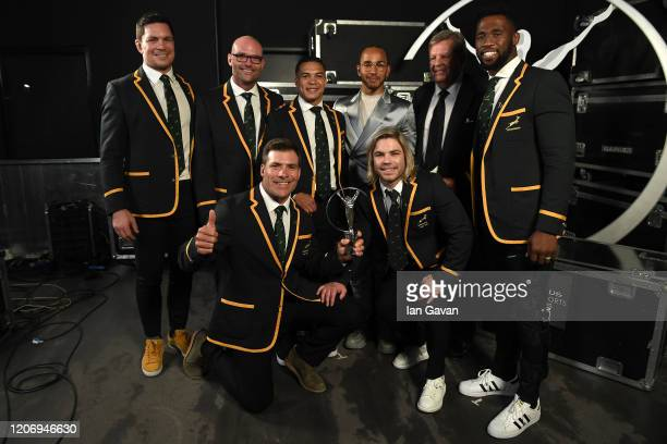 Members of Laureus World Team of the Year the South Africa Mens Rugby Team pose with Laureus World Sportsman of the Year British F1 driver Lewis...