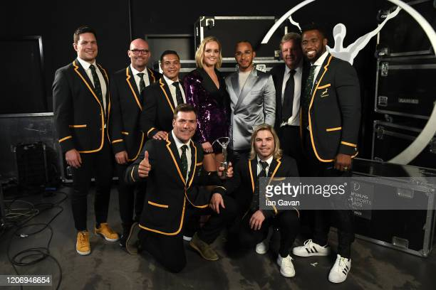Members of Laureus World Team of the Year the South Africa Mens Rugby Team pose with Host Amanda Davies Laureus World Sportsman of the Year British...