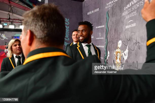 Members of Laureus World Team of the Year the South Africa Mens Rugby Team Faf de Klerk Schalk Brits Francois Louw and Siya Kolisi sign a wall during...