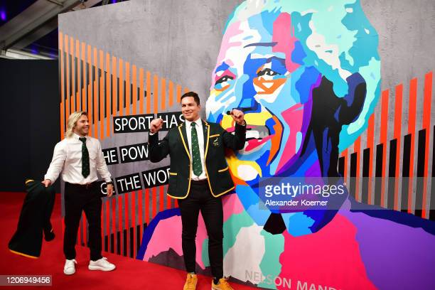 Members of Laureus World Team of the Year the South Africa Mens Rugby Team Faf de Klerk and Francois Louw pose during the 2020 Laureus World Sports...