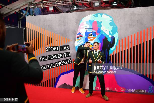 Members of Laureus World Team of the Year the South Africa Mens Rugby Team Francois Louw and Schalk Brits pose during the 2020 Laureus World Sports...